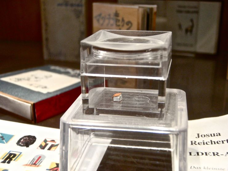 To see the supposed smallest book in the world, pay the Museum of Miniature Books a visit.  You won't be sorry.  Admission is free.
