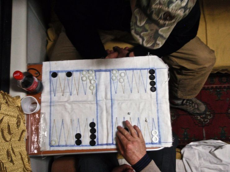 Our canvas backgammon board proved its worth once again in the cramped cabin of the Turkmenabat to Ashgabat overnight train.  The crusty gray-haired Red Army paratrooper we shared our cabin with didn't speak a word of English, but he sure could roll a pair of dice.